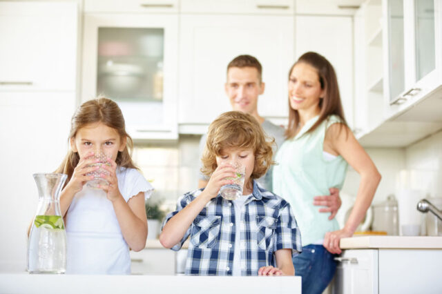 San Antonio Family Drinking Clean Water