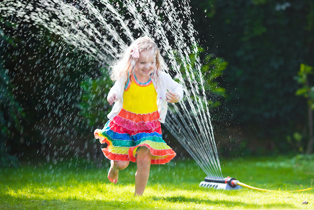 playing in water sprinkler